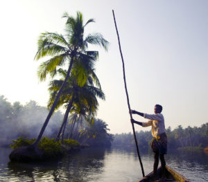 Indian Boatman and Traditional Boat